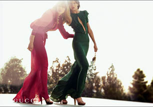 Gucci - Two Women -- Pink and Green One-Pieces